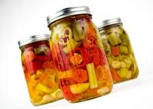 three glass mason canning jars of fresh organic ve Stock Images