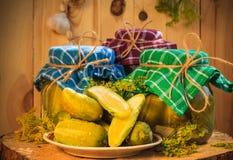 Jars pickled gherkins wooden table. Jars of pickled gherkins on a wooden table Royalty Free Stock Image