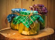 Jars pickled gherkins wooden table. Jars of pickled gherkins on a wooden table Royalty Free Stock Photo