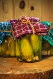 Jars pickled gherkins wooden table. Jars of pickled gherkins on a wooden table Stock Photo