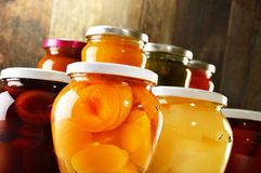 Jars with pickled vegetables, fruity compotes and jams Royalty Free Stock Image