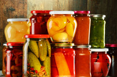 Jars with pickled vegetables, fruity compotes and jams Royalty Free Stock Photo