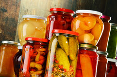 Jars with pickled vegetables, fruity compotes and jams Stock Photography