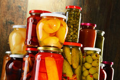 Jars with pickled vegetables, fruity compotes and jams Stock Images