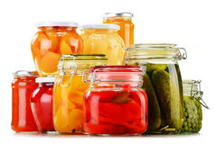 Jars with pickled vegetables, fruity compotes and jams Royalty Free Stock Images