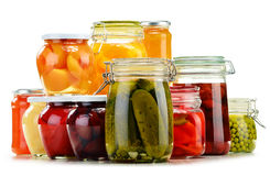Jars with pickled vegetables, fruity compotes and jams Stock Image