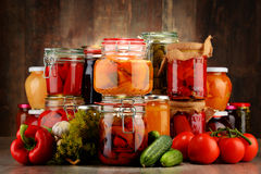 Jars with pickled vegetables and fruity compotes Royalty Free Stock Images