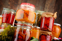 Jars with pickled vegetables and fruity compotes Stock Photo