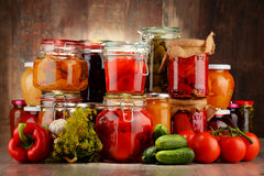 Jars with pickled vegetables and fruity compotes Royalty Free Stock Photo