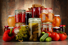 Jars with pickled vegetables and fruity compotes Stock Photography