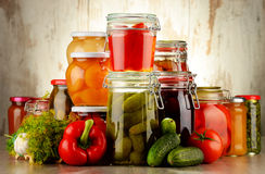 Jars with pickled vegetables and fruity compotes Stock Image
