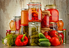 Jars with pickled vegetables and fruity compotes Royalty Free Stock Photography