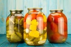 Jars of pickled vegetables. Marinated food. Stock Images