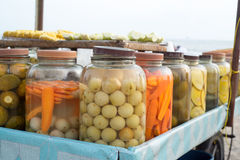 Jars of pickled vegetables. For sale Royalty Free Stock Photography