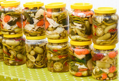 Jars of pickled vegetables for sale at Turkish bazaar. Jars with pickles, green tomatoes, pepper, cucumber, carrot. Royalty Free Stock Photo
