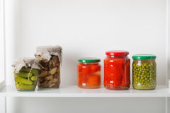 Jars with pickled vegetables. On white background Royalty Free Stock Image