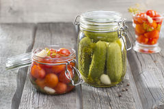 Jars with pickles Cucumbers, Tomatos, Custard Stock Images