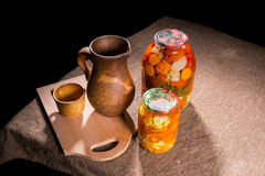 Jars of Pickles on Table with Wooden Handicrafts Stock Photography