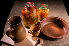 Jars of Pickles on Table with Wooden Handicrafts Stock Image