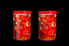 Jars With Pickles - With And Without White Panel Reflection Royalty Free Stock Image