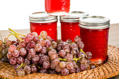 Jars of pink grape jelly Royalty Free Stock Photography