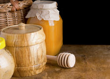 Jars and pot of honey on black background Royalty Free Stock Photos