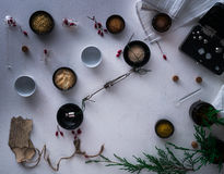 Jars of powders, barberry berries, leaves burnt paper, scales, a set  weights on the table. top view Stock Images