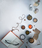 Jars of powders, book, glasses, sheets  charred paper on the table. top view Royalty Free Stock Images