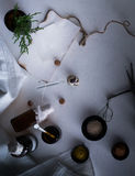 Jars of powders, leaves burnt paper, scales, a set  weights on the table. top view Stock Image