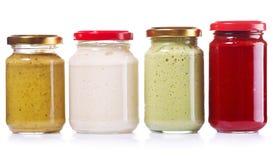 Jars of preserved mustard, ketchup, horseradish Stock Image