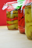 Jars of preserved peppers Stock Photography