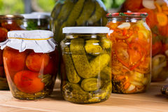 Jars of Preserved Vegetables on Wooden Table Royalty Free Stock Photography