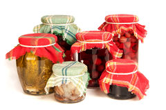 Jars of preserves on white Royalty Free Stock Photo