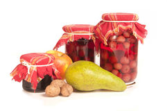 Jars of preserves on white Stock Photography