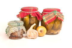 Jars of preserves on white Stock Photos