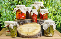 Jars of preserves on wooden table in the garden Royalty Free Stock Image