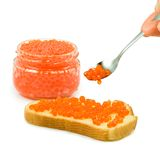 Jars with red caviar and bread with red caviar Stock Photo