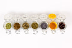 Jars with spices. Group of opened jars with spices Royalty Free Stock Photography