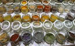 Jars with spices and dried aromatic herbs gathered all over the royalty free stock photo