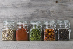 Jars with spices on an old stand. Stock Image