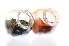 Jars with spices paprika and lovage isolated Stock Photo