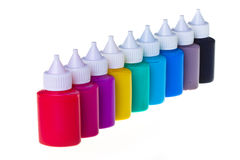 Jars stand with paint in number. On white background royalty free stock photo