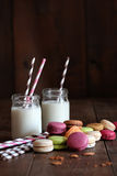Jars with straws and macaroons Royalty Free Stock Photos
