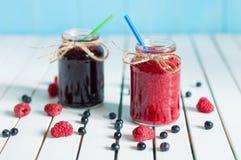 Jars of tasty jam on wooden background Stock Photo