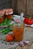 Jars of tomato sauce with chili, pepper and garlic. Bolognese sauce, lecho or adjika. Preservation. Canning Royalty Free Stock Photos