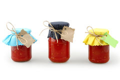 Jars with tomatoes Stock Photos
