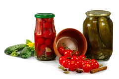 Jars with tomatoes and cucumbers isolate Royalty Free Stock Images