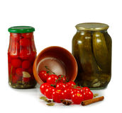 Jars with tomatoes and cucumbers Stock Photos