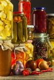 Jars with variety of pickled vegetables. Carrots, field garlic, parsley in glas. Preserved food. Fermented preserved vegetarian fo. Od concept Stock Images