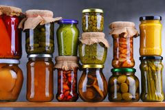 Jars with variety of pickled vegetables and fruits royalty free stock photography